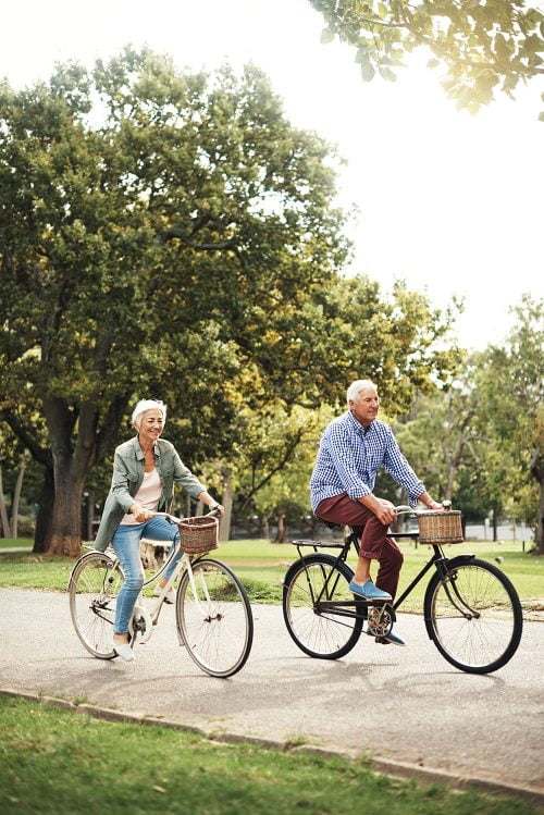 amroliving elderly couple riding bicycle e1544860809125 - Home