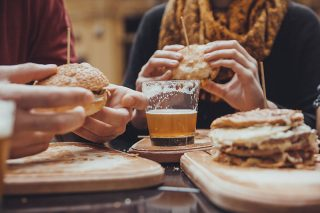amroliving friends eating burger and beer e1544860971958 - Home