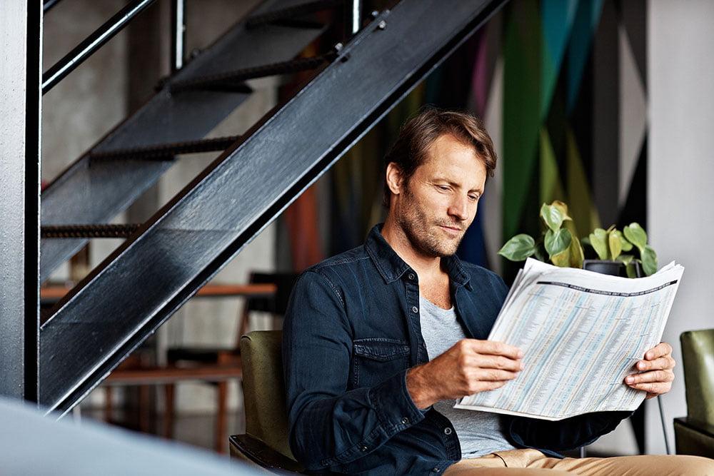 amroliving guy reading newspaper - Home